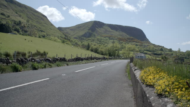 countryside road - northern ireland stock videos & royalty-free footage