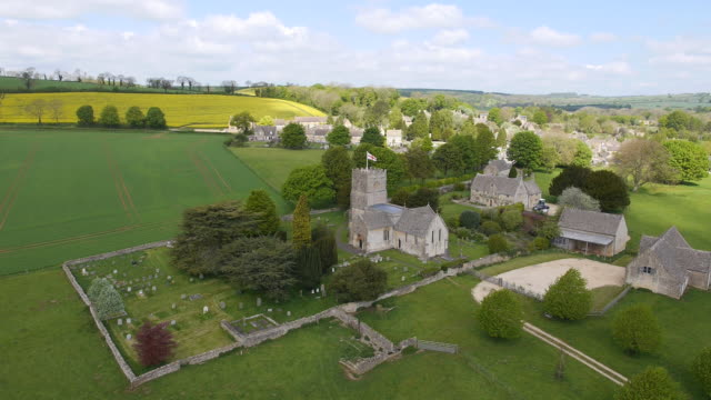 countryside view with church - aerial view - england stock videos & royalty-free footage