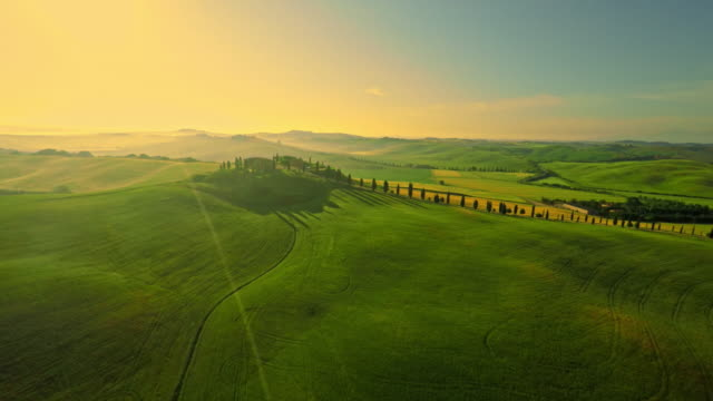 aerial countryside with a villa in the tuscany - twilight stock videos & royalty-free footage