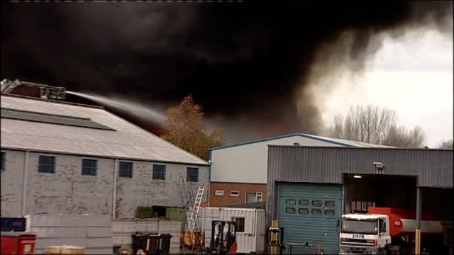 county durham: aycliffe: ext smoke and flames rising from warehouse on industrial estate as hosed down by firefighters column of black smoke - warehouse点の映像素材/bロール