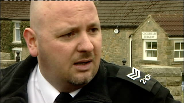 cockfield ext general views of reporter talking with police officer close shot of sealed plastic bag containing mephedrone plant food bought from the... - legal system stock videos and b-roll footage