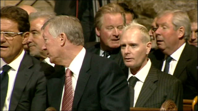 county durham durham cathedral int photograph of sir bobby robson people arriving for memorial service int congregation members of congregation... - イングランド ダラム点の映像素材/bロール