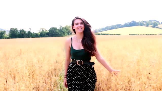 County girl, walking thru a meadow.