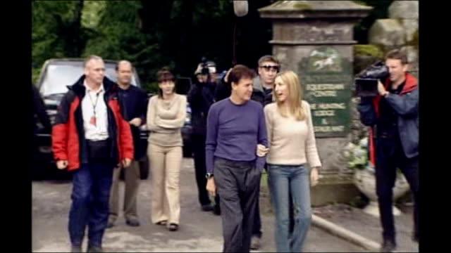 county monaghan: glaslough: mccartney and mills along mccartney handing mills red rose then couple kissing - リチャード・パロット点の映像素材/bロール