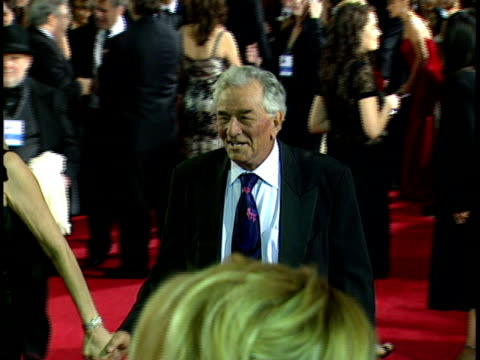 couple actress shera danese peter falk walking along crowded red carpet at beverly hilton hotel - peter falk stock-videos und b-roll-filmmaterial