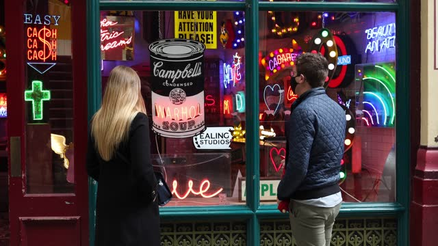 """couple admire the neon signs during the electric city, """"gods own junkyard's"""" exhibition photo call at leadenhall market on may 25, 2021 in london,... - incidental people stock videos & royalty-free footage"""