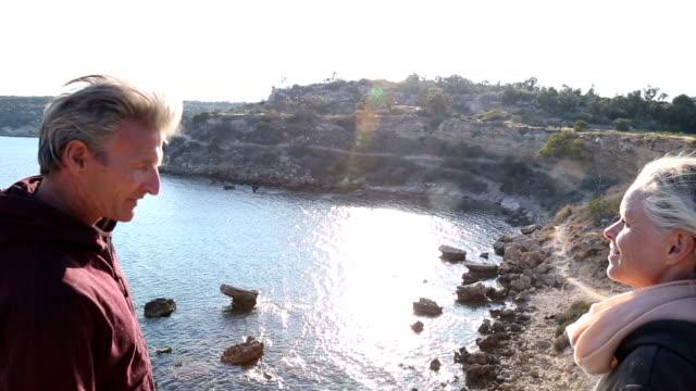 Couple admiring beautiful sea view