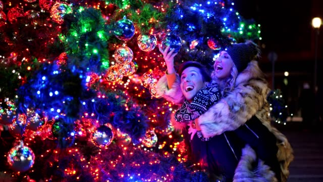 couple admiring christmas decoration - admiration stock videos and b-roll footage