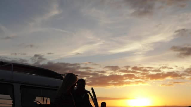 couple and camper van at sunset - camping stock videos and b-roll footage