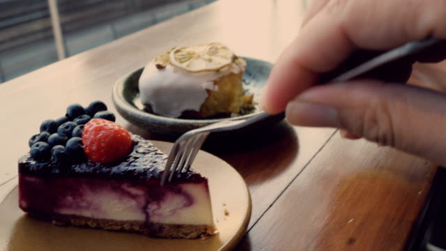 POV : Couple And CheeseCake At Cafe