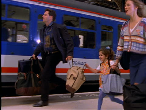 couple and young girl with luggage running to catch train / train station / london - suitcase stock videos & royalty-free footage