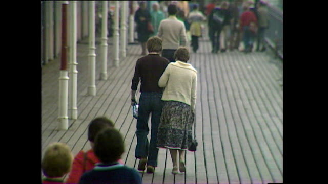 couple and young people enjoy weston pier; 1978 - timber stock videos & royalty-free footage