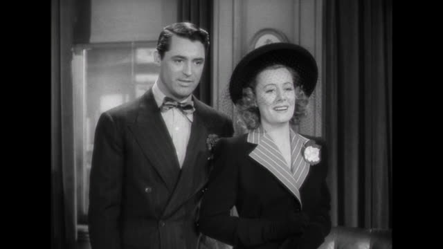 1941 Couple (Irene Dunne and Cary Grant) answer questions at adoption agency