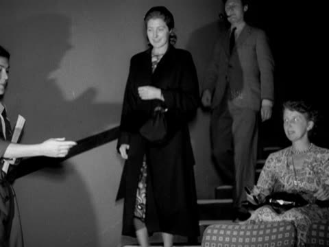 a couple are shown to their seats in the telekinema theatre at the festival of britain site 1951 - festival of britain stock videos & royalty-free footage