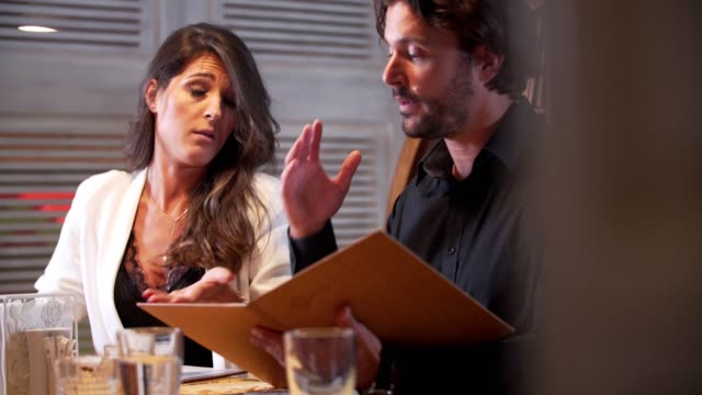 couple argue in the restaurant - battle of the sexes concept stock videos and b-roll footage