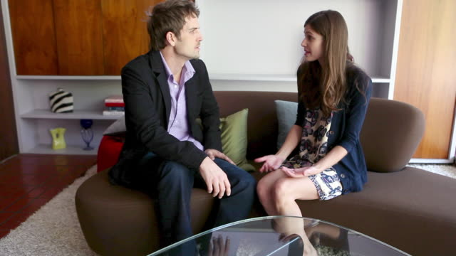 couple arguing on sofa - wife stock videos & royalty-free footage