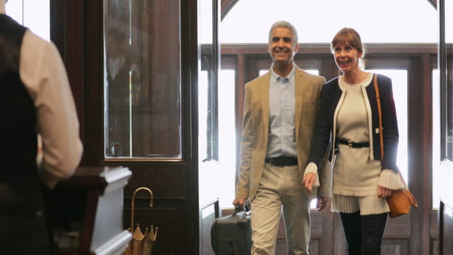 couple arriving at hotel - checkout stock videos & royalty-free footage