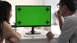 Couple Asian using Computer green screen