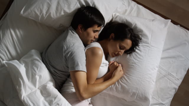 couple asleep in bed - pacific islander couple stock videos & royalty-free footage