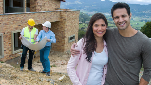Couple at a construction site building their house