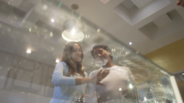 Couple at a jewellery store buying an engagement ring
