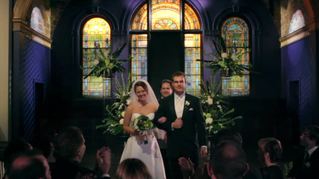WS couple at altar; PUSH IN as guests clap