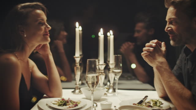 couple at candle light dinner - flirting stock videos & royalty-free footage