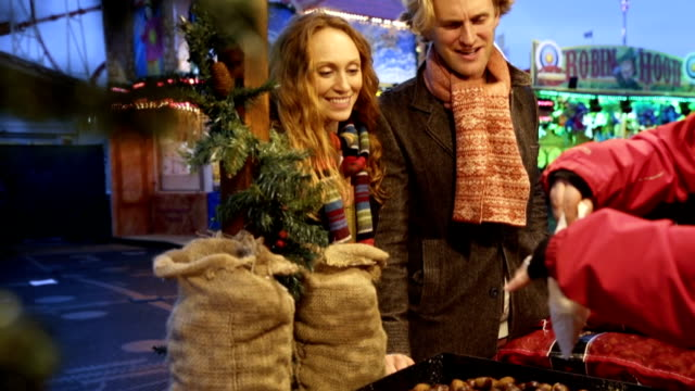 Couple at Christmas Market getting Snacks