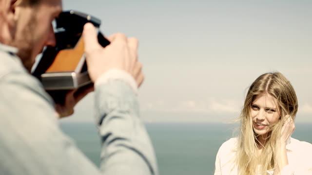 couple at coast - polaroid camera stock videos & royalty-free footage