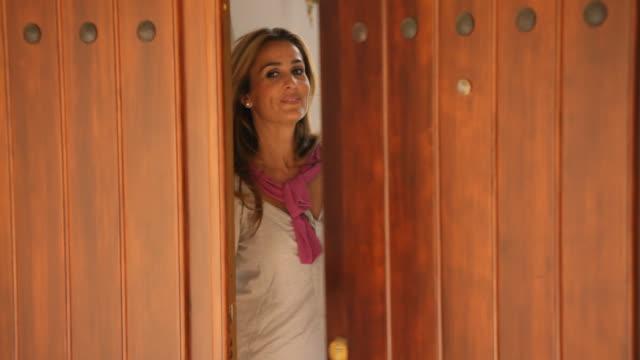 couple at doorway of villa - three quarter length stock videos & royalty-free footage