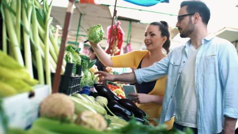 couple at food market. - organic farm stock videos & royalty-free footage