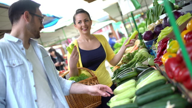 couple at food market. - courgette stock videos and b-roll footage