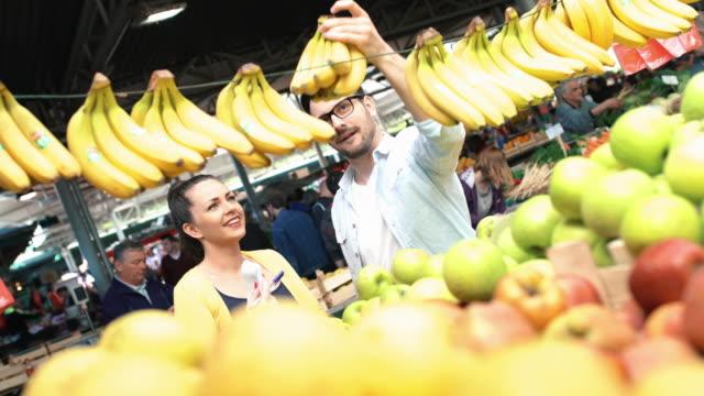 couple at food market. - banana stock videos & royalty-free footage