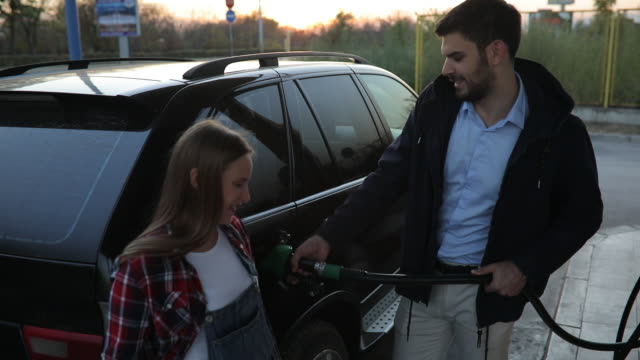 couple at gas station - fuel pump stock videos & royalty-free footage