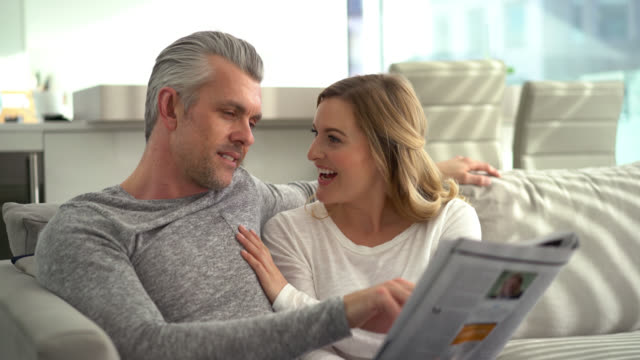 couple at home reading the newspaper - magazine publication stock videos & royalty-free footage