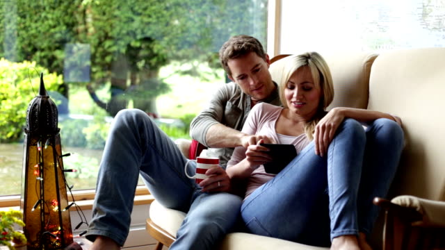 couple at home using a tablet - couple relationship stock videos & royalty-free footage