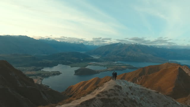 couple at mountain roy peak - new zealand stock videos & royalty-free footage