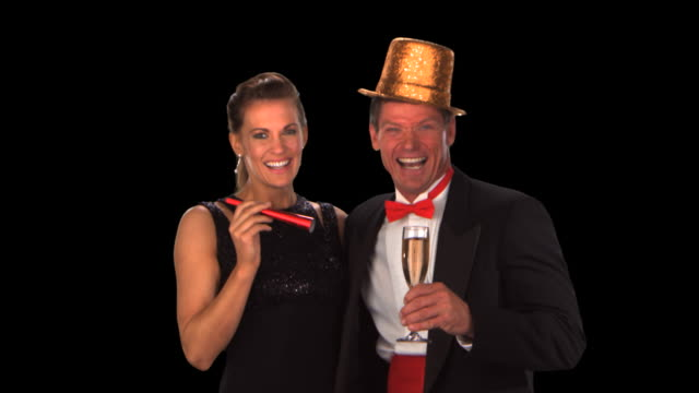 couple at new year's eve party - this clip has an embedded alpha-channel - keyable stock videos & royalty-free footage