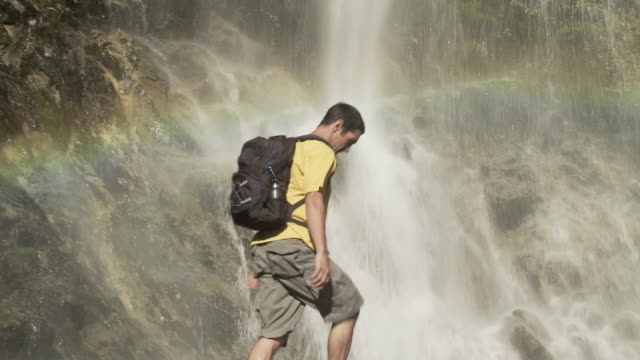 couple at picturesque waterfall - argentinian ethnicity stock videos & royalty-free footage