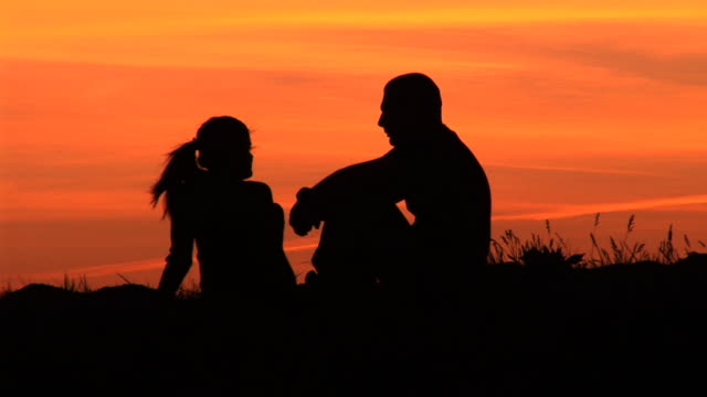 hd: couple at sunset - in silhouette stock videos & royalty-free footage