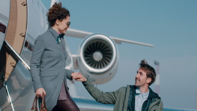 couple at the airport - private jet stock videos & royalty-free footage