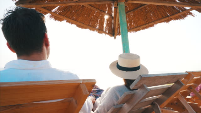 couple at the beach. - sunbed stock videos & royalty-free footage