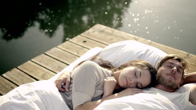 Couple awakening on lake