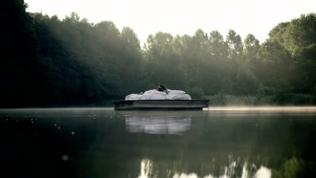 couple awakening on lake - floating moored platform stock videos & royalty-free footage