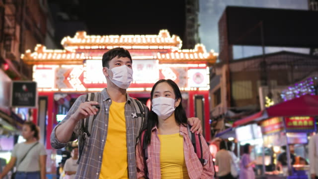 couple backpackers in night market - taipei stock videos & royalty-free footage