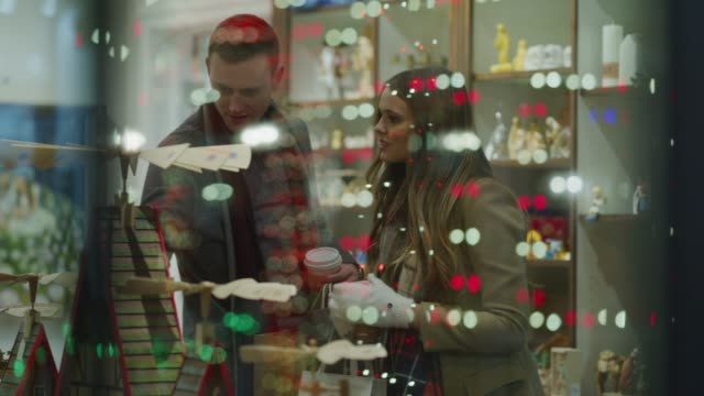 stockvideo's en b-roll-footage met couple behind window shopping in store at christmas / provo, utah, united states - provo