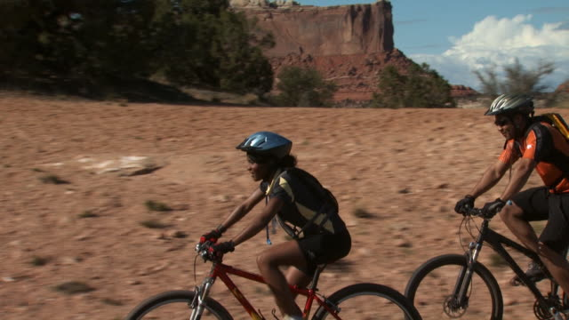 Couple biking with helmets