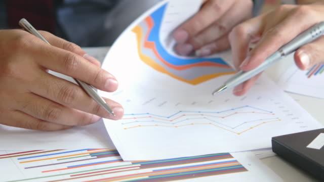 4K : Couple Businessman is analyzing business data