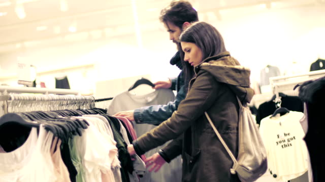 Couple buying clothes at the shopping mall