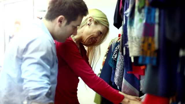 Couple buying clothes.